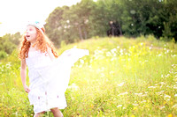 Girl running through a field in summer